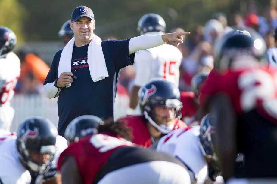 Texans head coach Bill O'Brien makes a call. Photo: Brett Coomer, Houston Chronicle