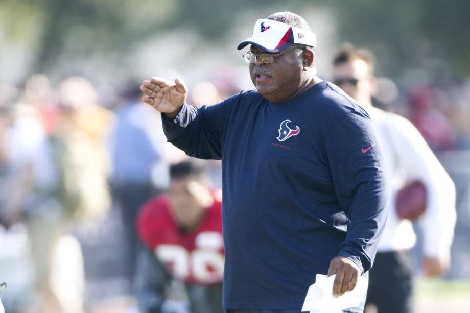 Texans defensive coordinator Romero Crennel makes a call. Photo: Brett Coomer, Houston Chronicle