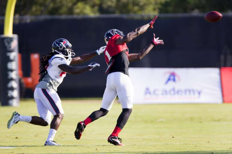 Atlanta Falcons wide receiver Julio Jones (11) reaches up to catch a pass with Texans safety Jawanza