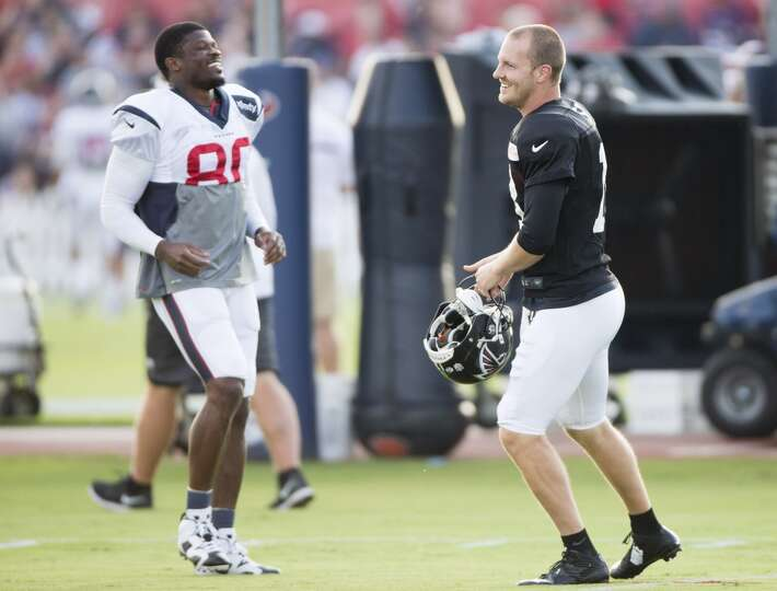 Texans wide receiver Andre Johnson (80) greets former teammate Atlanta Falcons quarterback T.J. Yate
