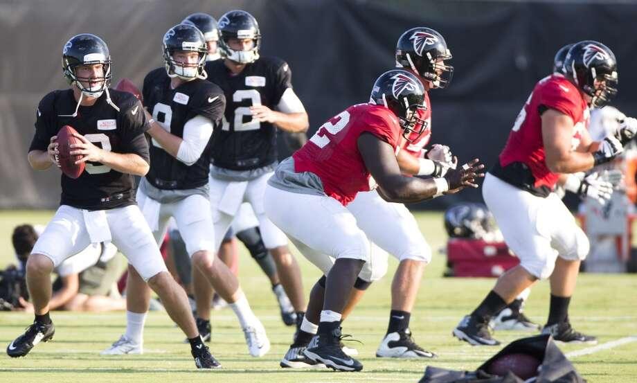 Atlanta Falcons quarterbacks T.J. Yates (13), Jeff Matthews (9) and Sean Renfree (12) drop back to pass. Photo: Brett Coomer, Houston Chronicle