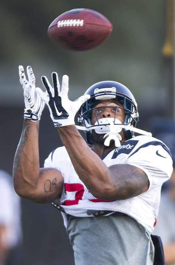Running back Arian Foster reaches up to catch a football. Photo: Brett Coomer, Houston Chronicle