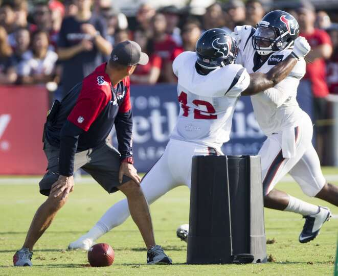 Texans running back Toben Opurum (42) blocks linebacker Justin Tuggle (57).