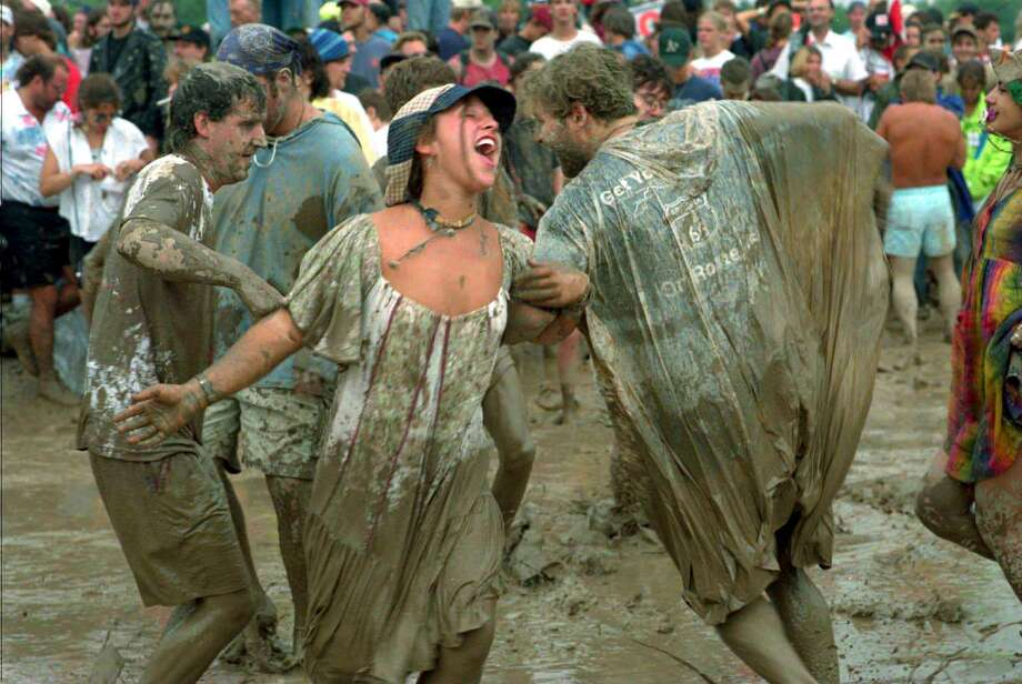 Times Union Staff Photo By Steve Jacobs  Aug. 14, 1994 -- A couple dances in the mud to Traffic in the North Stage area