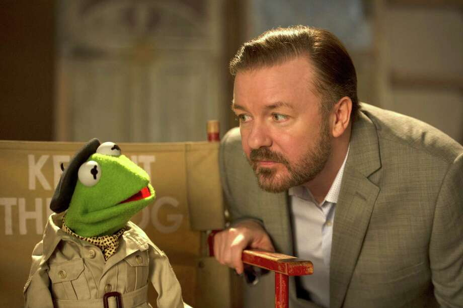 "This image released by Disney shows the muppet character Kermit the frog, left, and Ricky Gervais in a scene from ""Muppets Most Wanted."" (AP Photo/Disney Enterprises, Inc., Jay Maidment) ORG XMIT: NYET552 Photo: Jay Maidment / Disney"