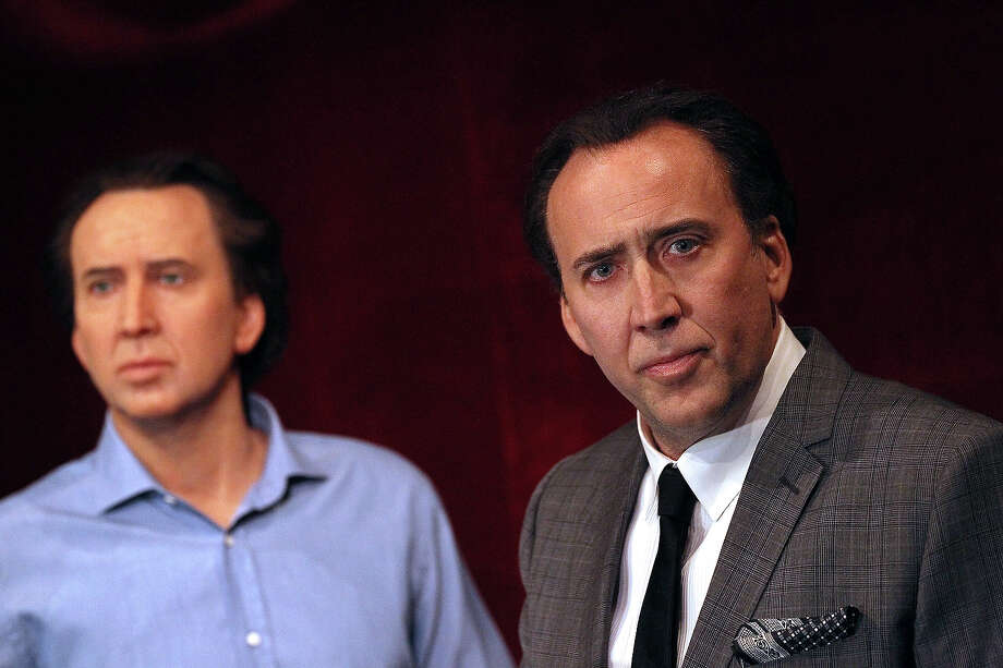 The wax double is probably just as lousy at acting as the real-live Nicolas Cage, seen here at Madame Tussauds in Paris.Click through this slideshow to see what other celebrities have posed with their wax likenesses at the famed tourist attraction. Photo: ALEXANDER KLEIN, AFP/Getty Images / 2012 AFP