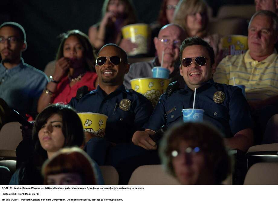 "In ""Let's Be Cops,"" Ryan (Jake Johnson, right) and Justin (Damon Wayans Jr.) think pretending to be officers is a lot of fun, but that's about to change. Photo: Frank Masi, SMPSP / TM and © 2014 Twentieth Century Fox Film Corporation.  All Rights Reserved.  Not for sale or duplication."