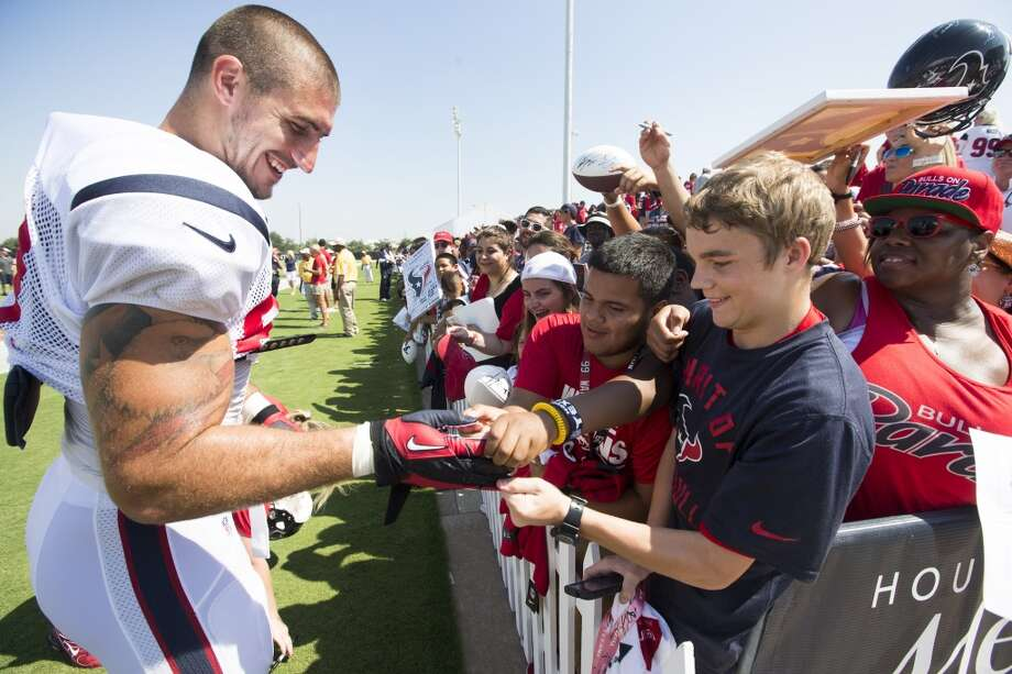 Texans tight end C.J. Fiedorowicz (87) gives a glove to a fan following practice. Photo: Brett Coomer, Houston Chronicle