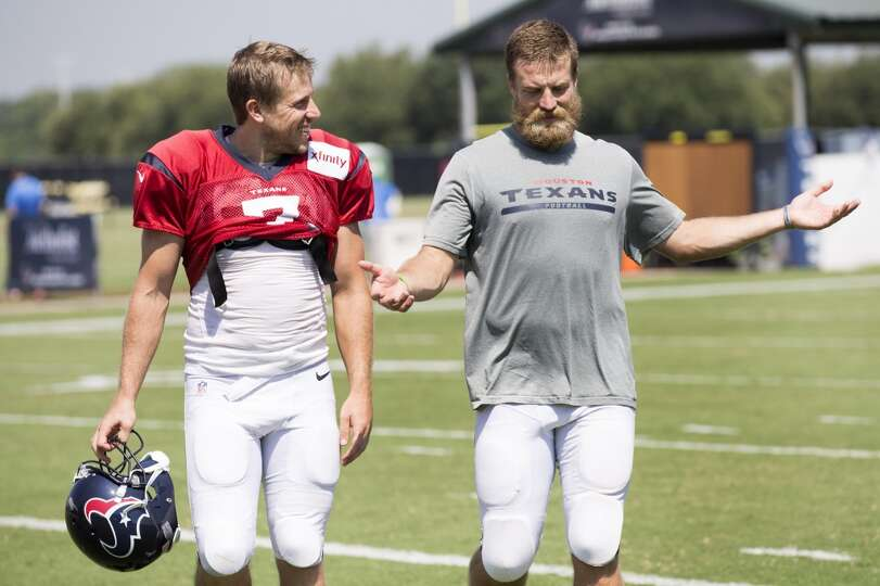 Texans quarterbacks Case Keenum (7) and Ryan Fitzpatrick walk off the practice field.