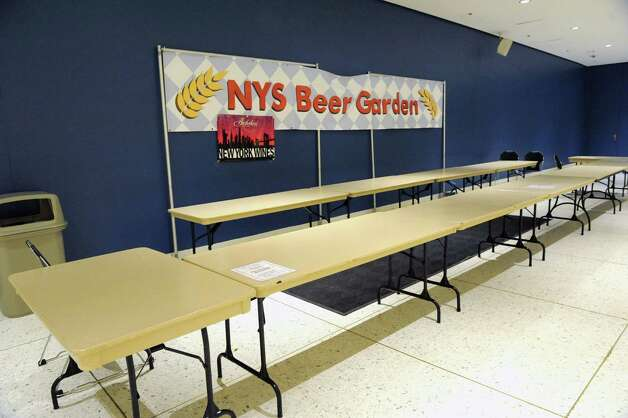 Tables are set up to sell beer for the The New York State Food Festival concerts at the convention center of the Empire State Plaza on Wednesday, Aug. 13, 2014, in Albany, N.Y. (Lori Van Buren / Times Union) Photo: Lori Van Buren / 00027123A