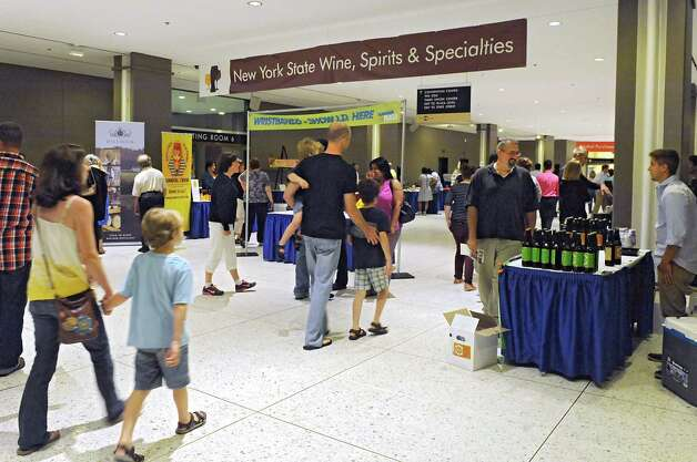 People walk through The New York State Food Festival near the Egg in the concourse of the Empire State Plaza on Wednesday, Aug. 13, 2014, in Albany, N.Y.  (Lori Van Buren / Times Union) Photo: Lori Van Buren / 00027123A