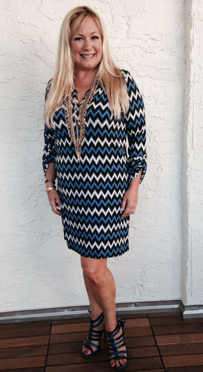 Ceslie Armstrong exudes summer confidence in her chevron-striped long-sleeved short dress that sh