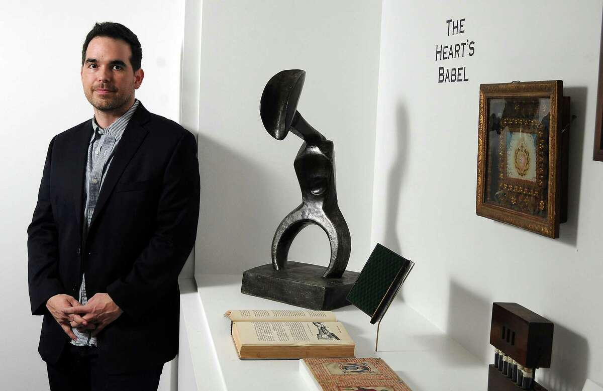 """Houston artist Dario Robleto placed Max Ernst's sculpture """"Man With a Fluttering Heart"""" with objects of his own making, including sculptures that appear to be antique books, in """"The Boundary of Life Is Quietly Crossed"""" at the Menil Collection. Houston artist Dario Robleto placed Max Ernst's sculpture """"Man With a Fluttering Heart"""" with objects of his own making, including sculptures that appear to be antique books, in """"The Boundary of Life Is Quietly Crossed"""" at the Menil Collection."""
