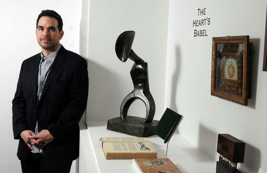 """Houston artist Dario Robleto placed Max Ernst's sculpture """"Man With a Fluttering Heart"""" with objects of his own making, including sculptures that appear to be antique books, in """"The Boundary of Life Is Quietly Crossed"""" at the Menil Collection.          Houston artist Dario Robleto placed Max Ernst's sculpture """"Man With a Fluttering Heart"""" with objects of his own making, including sculptures that appear to be antique books, in """"The Boundary of Life Is Quietly Crossed"""" at the Menil Collection. Photo: Dave Rossman, Freelance / © 2014 Dave Rossman"""