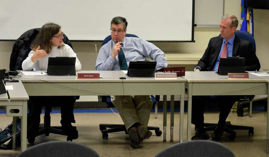 The New Canaan Board of Selectmen - Beth Jones, Robert Mallozzi and Nick Williams - during a meeting at the Police Department in New Canaan, Conn., on Tuesday, Dec. 17, 2013. Photo: Nelson Oliveira / New Canaan News
