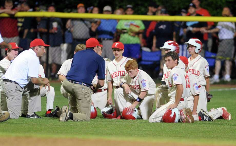 Scenes from the New England Regional Little League championship game between Fairfield American and Cumberland American (Rhode Island) Saturday, Aug. 9, 2014, at Breen Field in Bristol, Conn. Photo: Autumn Driscoll / Connecticut Post