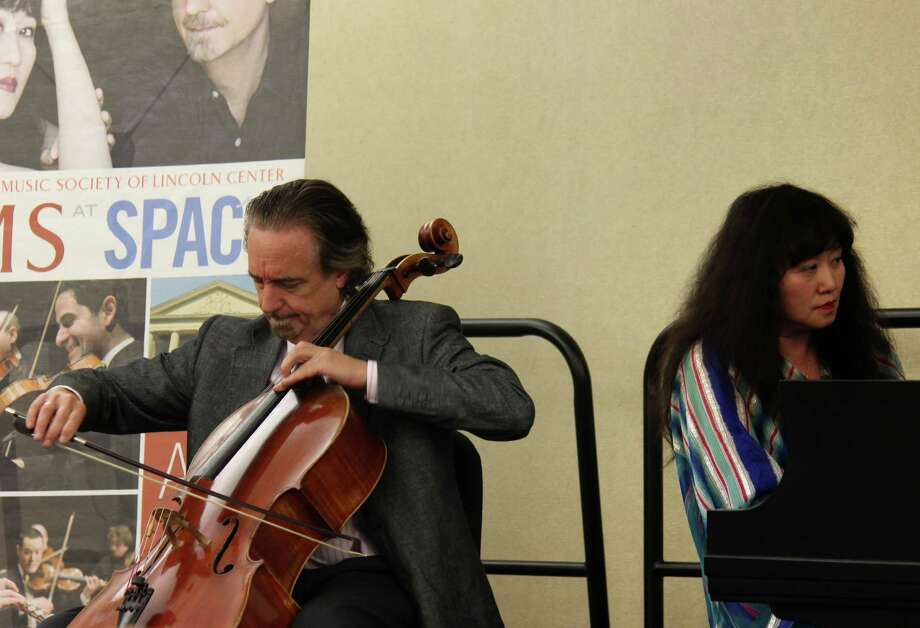 Cellist David Finckel and pianist Wu Han perform a concert at the Clifton Park-Halfmoon Library on Wednesday afternoon, August 13, 2014, in Clifton Park N.Y. (Selby Smith/Special to the Times Union) Photo: Selby Smith / 00028164A