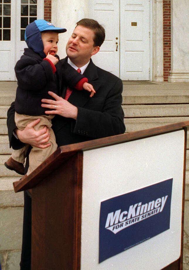 John McKinney holds his one year old son, Matthew, while announcing his candidacy for State Senate in Newtown, Conn. in 1998. Photo: File Photo/David W. Harple, David W. Harple / The News-Times File Photo