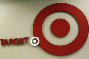 "(FILES) This November 17, 2012 file photo shows the Target logo at a store in Stamford, Connecticutt.  Giant US retailer Target -- the store with the bull's-eye as a logo -- says it does not want customers running around its shops carrying guns, even if it is legal. Target announced July 2, 2014 it would ""respectfully request"" shoppers not to bring firearms into its stores, ""to create an atmosphere that is safe and inviting for our guests and team members."" With 44 of the 50 US states permitting people to openly carry handguns day-to-day, interim chief executive John Mulligan said in a statement that Target, which has nearly 1,800 stores in the United States, seeks to adhere to local regulations. AFP PHOTO/DON EMMERTDON EMMERT/AFP/Getty Images"
