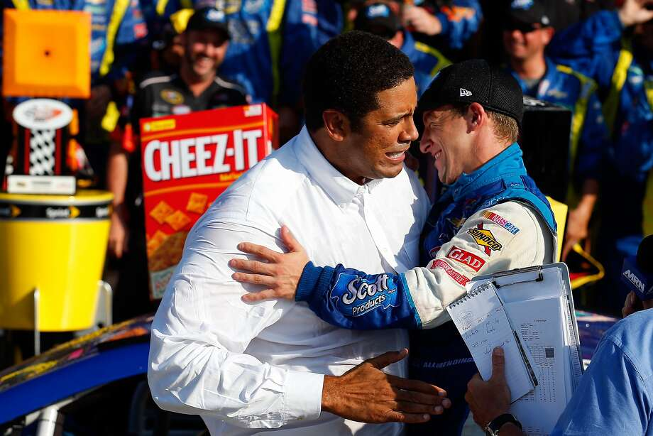 AJ Allmendinger (right) hugs team co-owner Brad Daugherty in Victory Lane after their first Sprint Cup victory at Watkins Glen International on Sunday. Photo: Tom Pennington, Getty Images