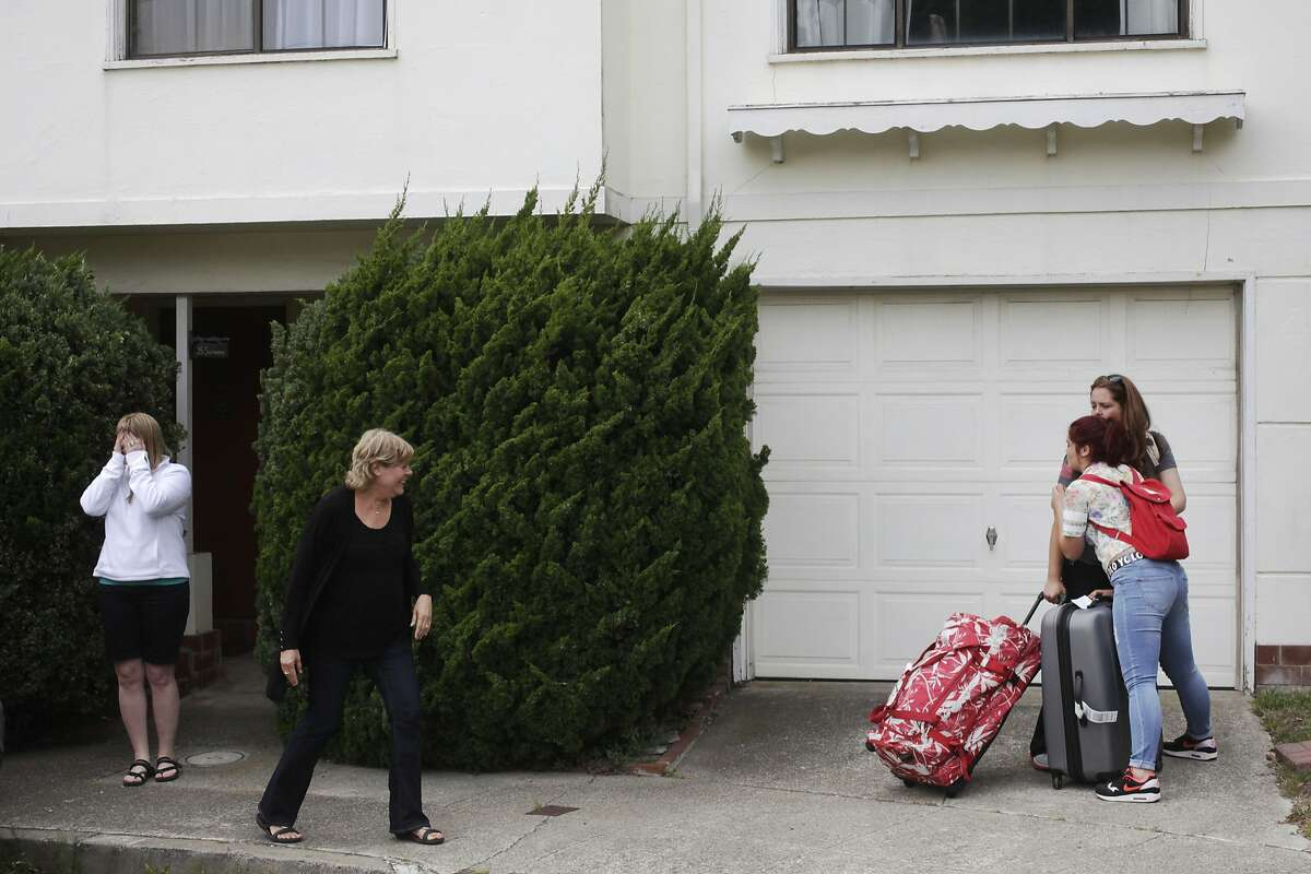 Airbnb rental clients, who preferred not to give their names, greet family members after arriving at their place for a wedding August 6, 2014 in a Twin Peaks cul-de-sac in San Francisco, Calif. A group of neighbors who live on the street are upset about an increase of homes that are being rented to Airbnb. Of 34 homes on the street, three are now Airbnb, according to the neighbors.