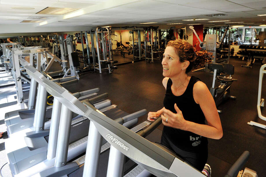 Laura Liebesman runs on a treadmill in the fitness room at the Greenwich Office Park in Greenwich, Conn., on Monday, Aug. 11, 2014. Many real estate agencies are including a host of ammenities to lure prospective tenants to their facility. Photo: Jason Rearick / Stamford Advocate