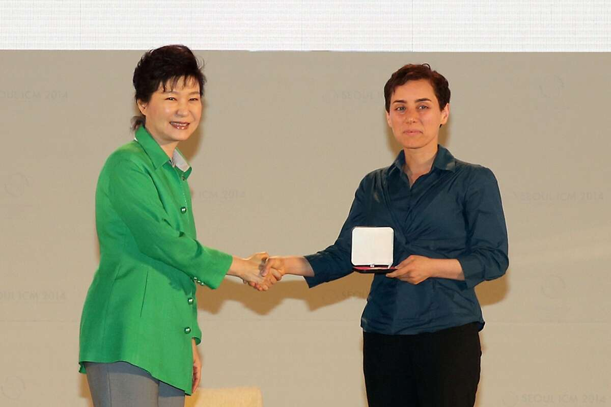 South Korean President Park Geun-Hye (L) giving the prize to Maryam Mirzakhani (R), a Harvard educated mathematician and professor at Stanford University in California, at the awards ceremony for the Fields Medals during the International Congress of Mathematicians 2014 in Seoul. She was both the first woman and the first Iranian honored with the Fields Medal, the most prestigious award in mathematics.