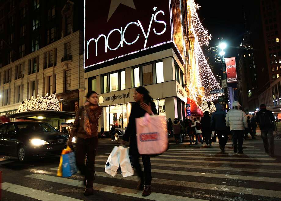 FILE - AUGUST 13:  According to reports August 13, 2014, Macy's Inc. has cut it's sales forecast for the year when 2nd quarter sales didn't make up for first quarter weather related weakness. NEW YORK - DECEMBER 22:  Shoppers and pedestrians cross 34th Street outside of Macy's Herald Square department store after 10pm December 22, 2009 in New York City.  Macy's is staying open 24 hours a day in hopes to boost retail sales numbers in the runup to the Christmas holiday.  (Photo by Chris Hondros/Getty Images) Photo: Chris Hondros, Getty Images