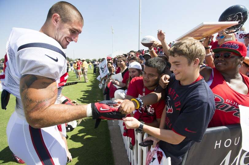 Texans tight end C.J. Fiedorowicz (87) gives a glove to a fan following practice.