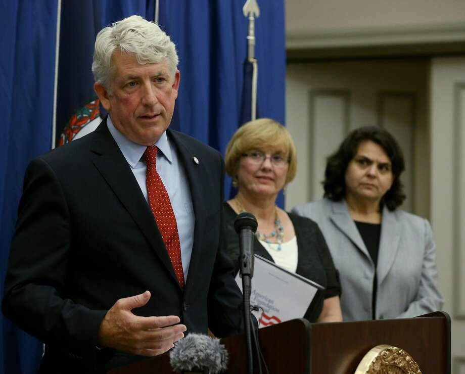 Virginia Attorney General Mark Herring speaks at a July news conference with plaintiff Mary Shaw Townley (center) and Rebecca Glenberg of the ACLU. Photo: Bob Brown, Associated Press