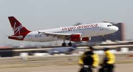 FILE - In this Dec. 1, 2010 file photo, a Virgin America jet that departed from Los Angeles arrives at Dallas Fort Worth International Airport in Grapevine, Texas. The California-based airline on Monday, July 28, 2014 filed for an initial public offering of shares. (AP Photo/LM Otero, File)