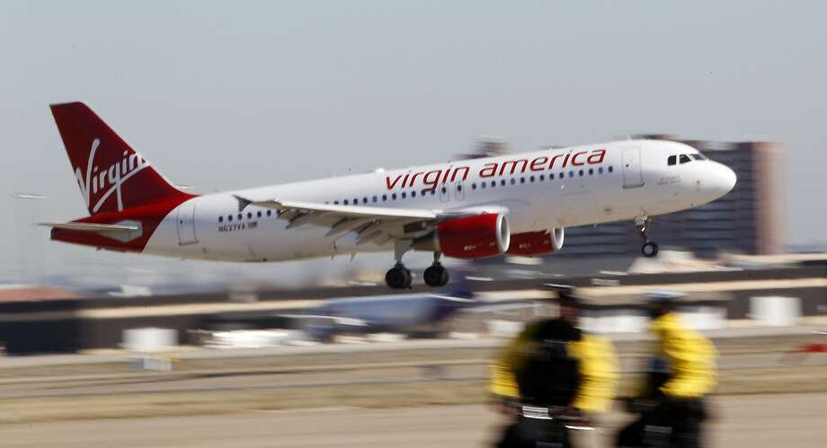 Flight attendants at Virgin America will begin crafting a contract with the airline after they voted to form a union at the Burlingame company. Photo: LM Otero, Associated Press