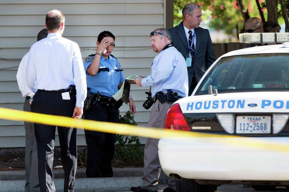 Law enforcement officers investigate the scene of an officer-involved shooting near the intersection of Airline and Aldine-Bender Wednesday, Aug. 13, 2014, in Houston. One officer and one suspect were transported to area hospitals following the shooting. Photo: Brett Coomer, Houston Chronicle / © 2014 Houston Chronicle