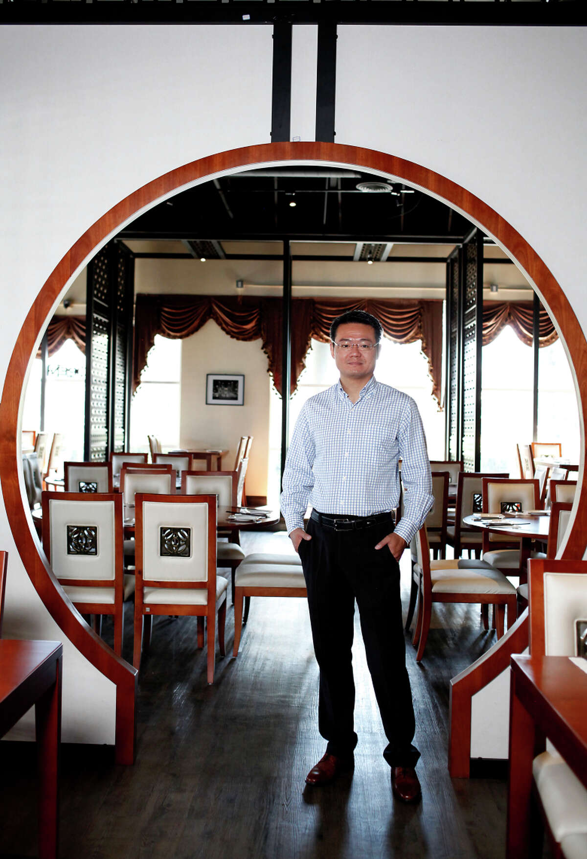 Allen Shi, the owner of the new China Lounge, in Pleasanton, Calif., on Friday, August 8, 2014.