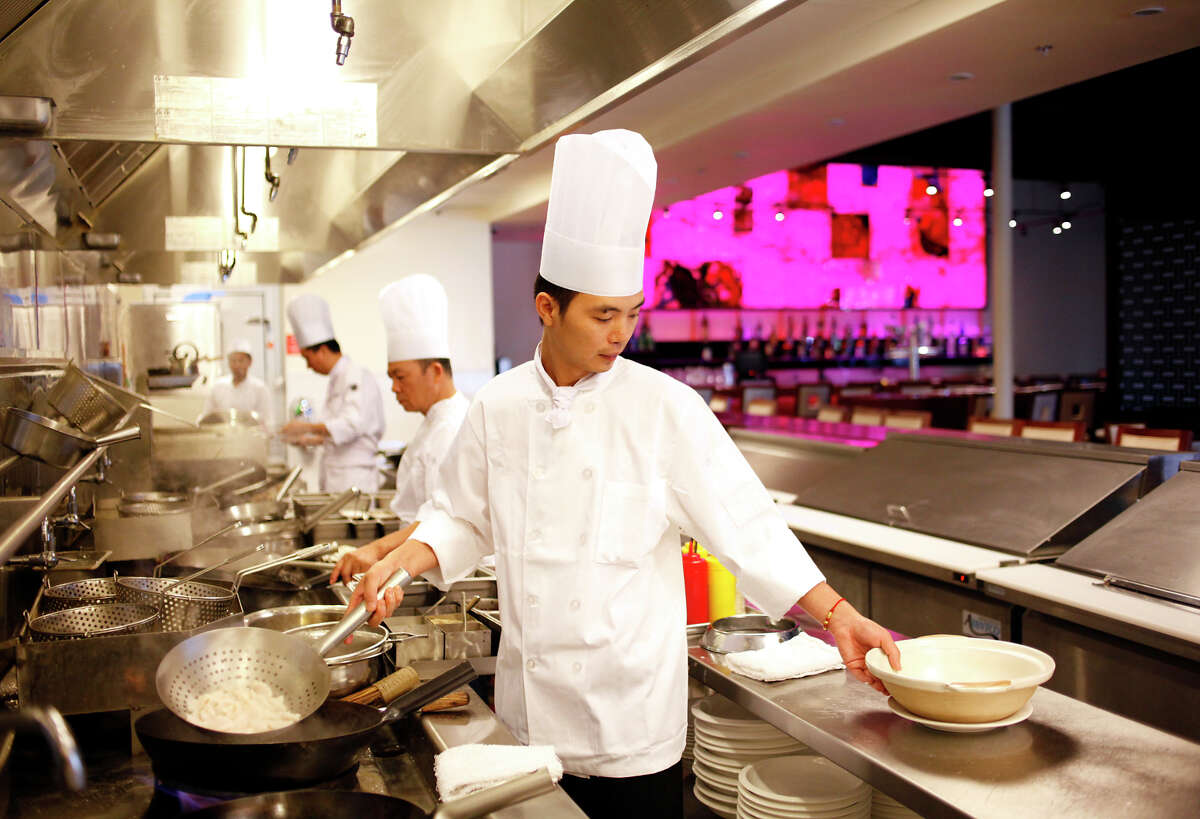 Chef Jian Li works in the open kitchen at China Lounge in Pleasanton, Calif., on Friday, August 8, 2014.