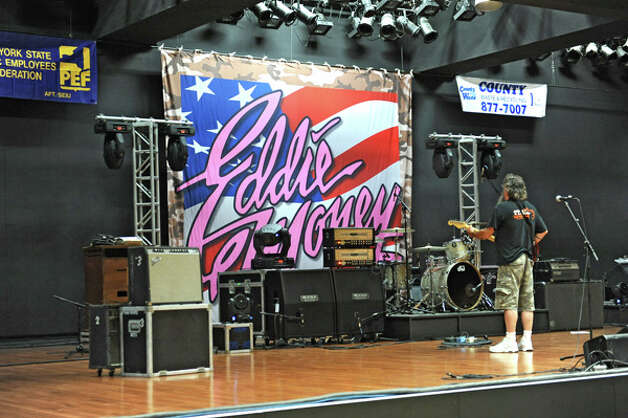 Sound checks are performed on the convention center's stage for the The New York State Food Festival concerts at the Empire State Plaza on Wednesday, Aug. 13, 2014 in Albany, N.Y. The farmers market, vendors from The New York State Food Festival and performers including headliner Eddie Money were brought inside due to a rainy forecast. (Lori Van Buren / Times Union) Photo: Lori Van Buren, Albany Times Union / 00027123A
