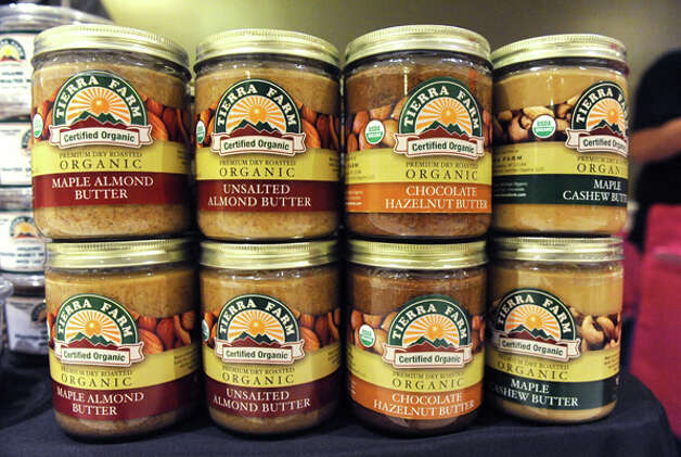 A variety of nut butters are sold during The New York State Food Festival in the concourse of the Empire State Plaza on Wednesday, Aug. 13, 2014 in Albany, N.Y. The farmers market, vendors from The New York State Food Festival and performers including headliner Eddie Money were brought inside due to a rainy forecast. (Lori Van Buren / Times Union) Photo: Lori Van Buren, Albany Times Union / 00027123A