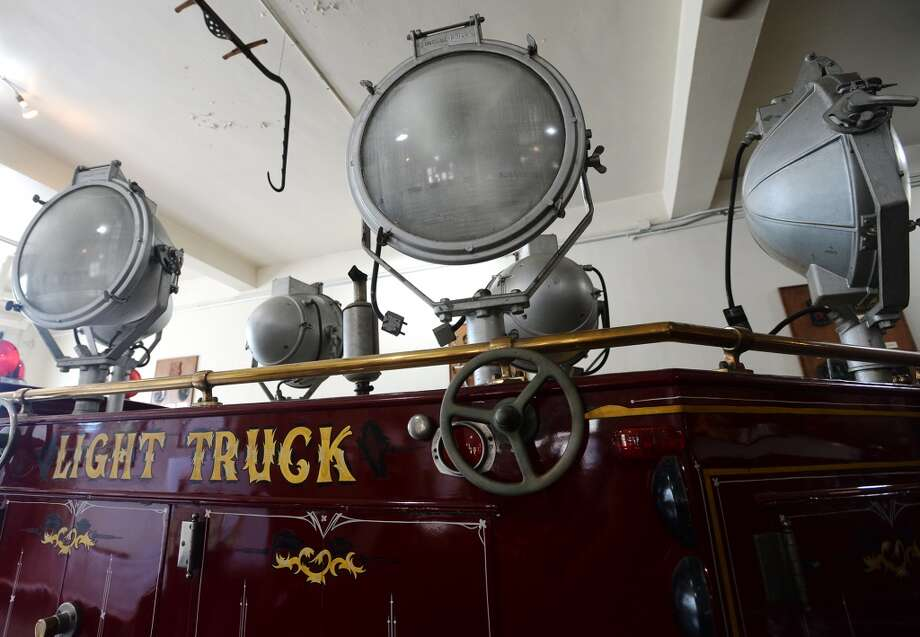 "Pictured is the original light truck, with its five 1500 watt floodlights and one 2000 watt spotlight, used by three Beaumont firefighters to assist in the relief efforts at Texas City. The truck resides in the Fire Museum of Texas. The Fire Museum of Texas is currently hosting ""Texas City Burning,"" a collection of photographs from the 1947 Texas City Disaster. The exhibit, which chonicles the deadliest industrial disaster in United State history, will be on display until June 30. On April 16, 1947, the SS Grandcamp's cargo of 2,300 tons of ammonium nitrate detonated, devastating the surrounding port, and killing at least 581 people. The city of Beaumont sent a then state-of-the-art light truck and three firefighters to help in the recovery efforts. Photo taken Monday 6/2/14 Jake Daniels/@JakeD_in_SETX Photo: Jake Daniels"