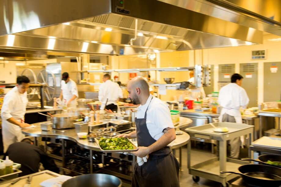 A robust kitchen staff and equipment will be churning out meals for the thousands of fans on game day at the new Michael Mina restaurant Bourbon Steak & Pub at Levi's Stadium in Santa Clara. Photo: Jason Henry, Special To The Chronicle