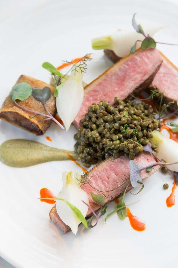 From Bourbon Steak: The 38 North Dry-Aged Duck with madras curry, caramelized orange and topped with whipped lentils. $38. Photo: Jason Henry, Special To The Chronicle