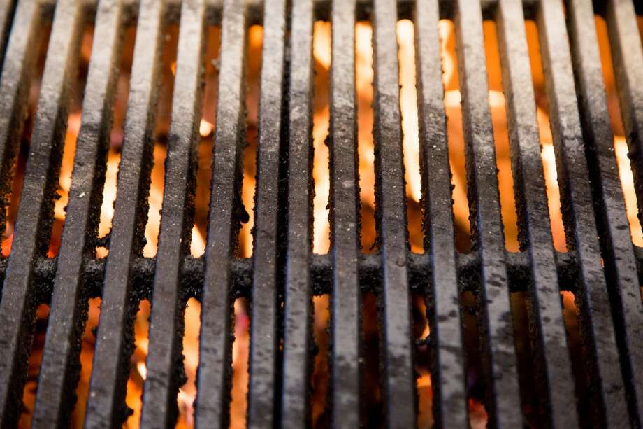 A wood-fired grill in the kitchen. Photo: Jason Henry, Special To The Chronicle