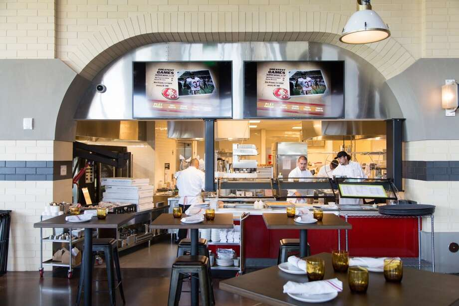 The large Pub dining area with open view kitchen. Photo: Jason Henry, Special To The Chronicle
