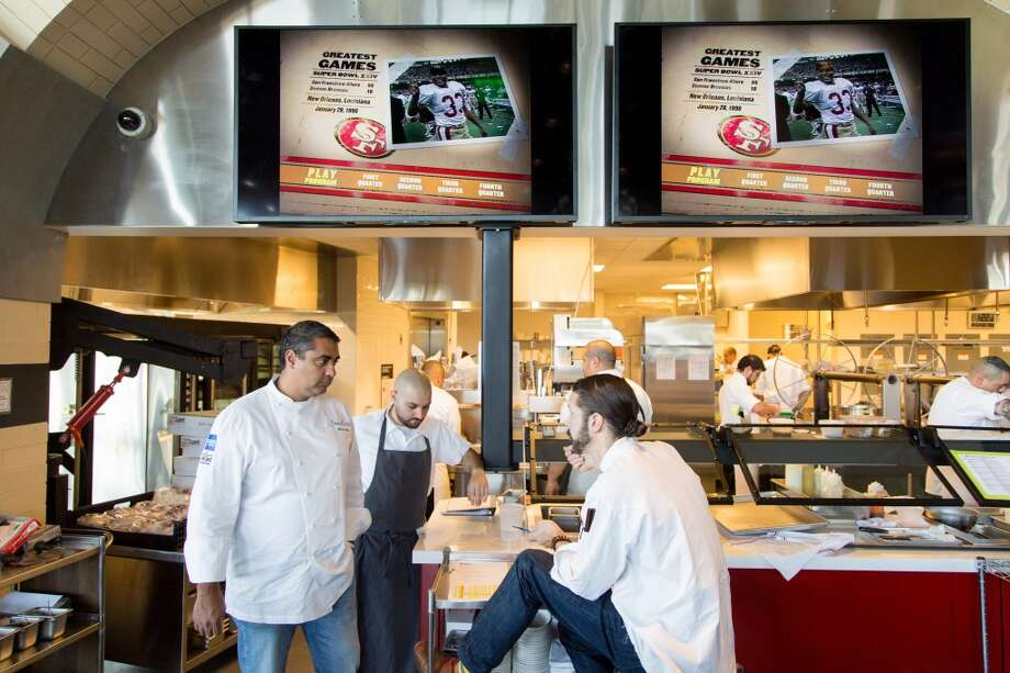 Michael Mina, left, talks with two of his chefs. Photo: Jason Henry, Special To The Chronicle