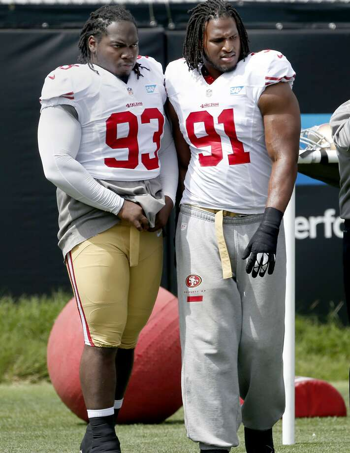 Ian Williams (93) and Ray McDonald (91) stood together as practice began in Santa Clara, Calif. The San Francisco 49ers held their first practice since returning from Baltimore Wednesday August 13, 2014. Photo: Brant Ward, San Francisco Chronicle