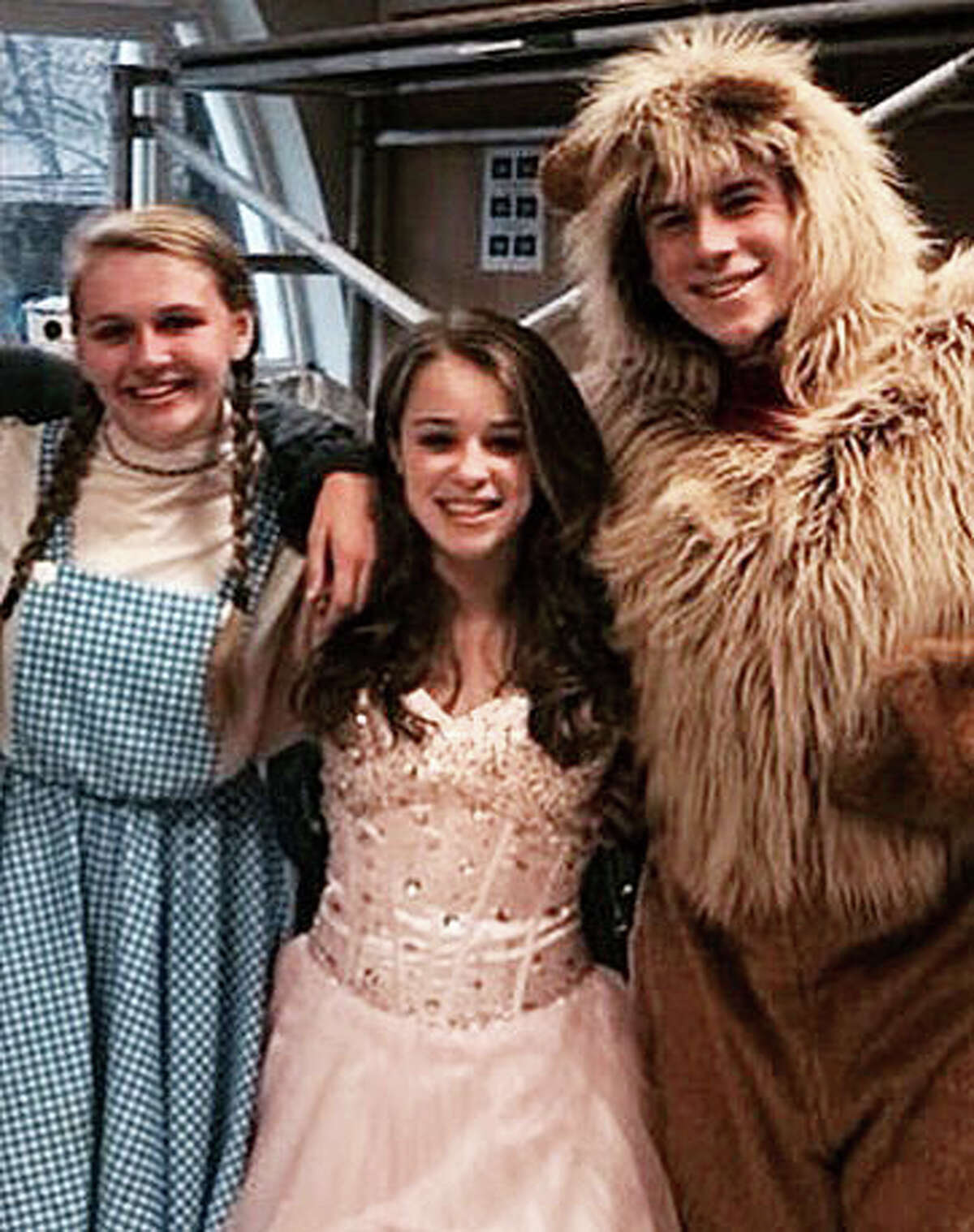 This provided photo shows Emily Fedorko, center, when she played Glinda the Witch in the Greenwich High School's production of Wizard of Oz in late 2013.