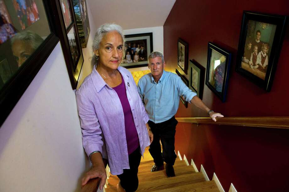 Each time Debra and Marc Tice pass the family photos lining their stairs, they think of their missing son. Photo: Marie D. De Jesus, Staff / © 2014 Houston Chronicle