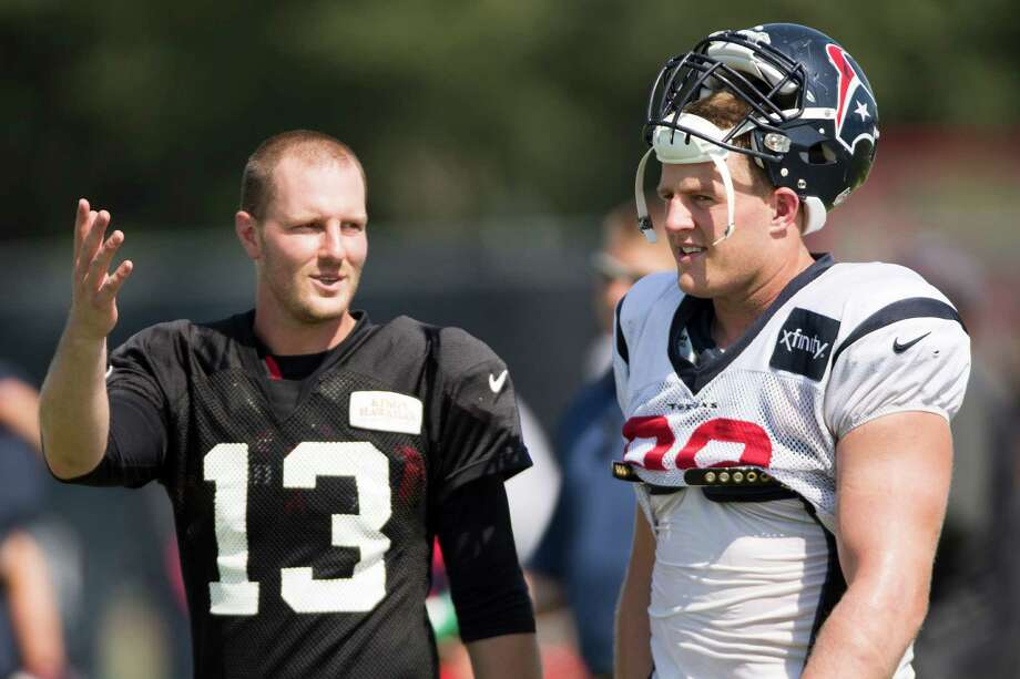 Atlanta Falcons quarterback T.J. Yates (13) talks to Houston Texans defensive end J.J. Watt (99) after practice during Texans training camp at the Methodist Training Center Wednesday, Aug. 13, 2014, in Houston.  ( Brett Coomer / Houston Chronicle ) Photo: Brett Coomer, Staff / © 2014 Houston Chronicle