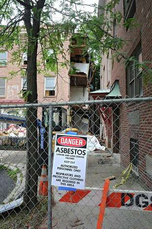 Exterior of 1 Columbia Place on Wednesday, Aug. 13, 2014 in Albany, N.Y. Officials are trying to figure out whether the recent floods caused the historic building, once used by sculptor Erastus Dow Palmer, to begin to collapse. (Lori Van Buren / Times Union) Photo: Lori Van Buren / 00028159A