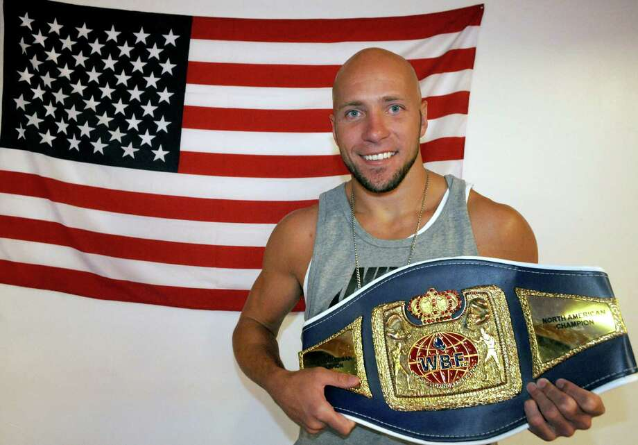 Professional boxer Shawn Miller with his WBF light heavy weight North American championship belt at Millhouse Boxing on Wednesday Aug.13, 2014 in Cohoes, N.Y. (Michael P. Farrell/Times Union) Photo: Michael P. Farrell / 00028146A