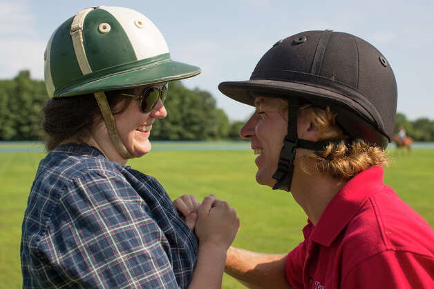 Deanna Fox, left, and Mario Dino, right, share a laugh together Friday morning, Aug. 8, 2014, at the Saratoga Polo Association grounds in Saratoga Springs, N.Y. (Tom Brenner/ Special to the Times Union) Photo: Tom Brenner / ©Tom Brenner/ Albany Times Union